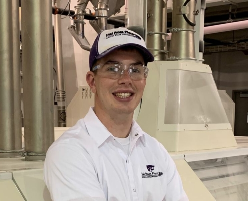Cody Blodgett in a flour mill, resting against a rollstand