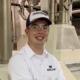 Cody Blodgett in a flour mill, resting against a rollstand