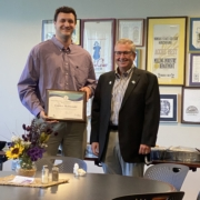 Conner McDonald (left) receives the IMEF Grain Millers'/Christian F. Kongsore Scholarship for the second time. IMEF President Randy Garvert presents the scholarship at a recent Milling Science Club meeting at Kansas State University.