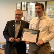 IMEF President Randy Garvert (left) presents the second IMEF Grain Millers'/Christian F. Kongsore Scholarship to Andrew Kent during a recent Milling Science Club meeting at Kansas State University.