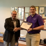 IMEF President Randy Garvert (left) presents the IMEF Distinguished Professors' Scholarship to Brenden Meeks during a recent Milling Science Club meeting at Kansas State University.